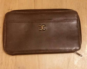 Vintage brown leather zippered wallet, multiple compartments.
