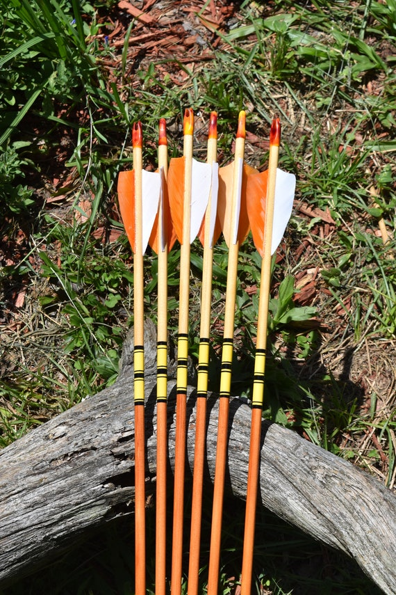 Archery arrows, wood arrows, Orange and yellow arrows