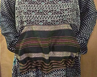 One-of-a-kind 100% up-cycled vintage sari silk unique, multi-patterned tunic with over-sized cowl neck and front pocket detail