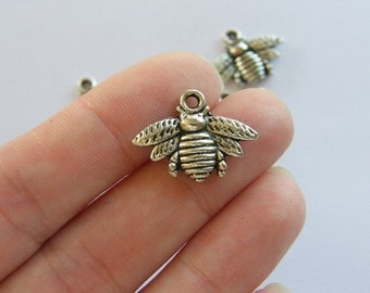 10 Bee charms antique silver tone A315