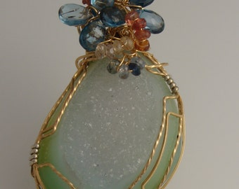 Light green-blue druzy with topaz and sapphire