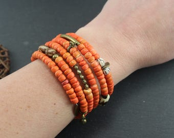 Cuff ethnic memory MULTISTRAND wrap, orange and bronze beads coco, Horn, wood, seeds, charms