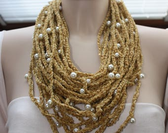 Crochet necklace with gold chenille yarn mixed with microsequined yarn and white pearls