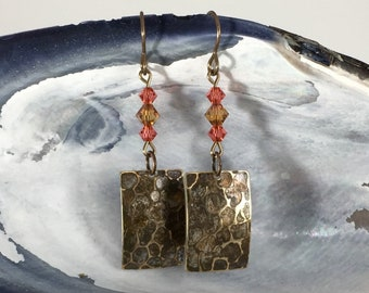 Earrings: hammered with gold bronze patina + amber rose swarovski crystals