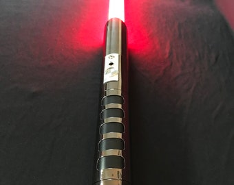 Star wars dueling lightsaber with in-hilt LED blade and with sound / effects