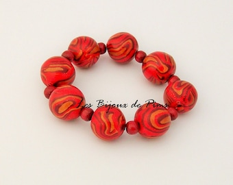 Red bracelet with polymer clay