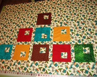 Unfinished, lap/baby quilt TOP, large squares in green, red, brown, gold, & turquoise w/ small square inside; featuring retro Camping fabric