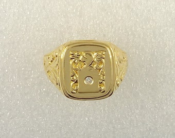 Men's ring with chevalier and seal in 18kt gold and 0.02kt diamond