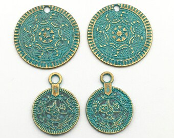 4 ethnic charms green patina and gold tone ,23mm  to 25mm # CH 554