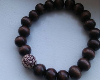 Chocolate Bead with Cream Flower accent