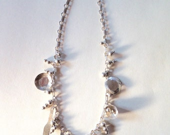 Hand-crafted Artisan Dinnerware Necklace in Sterling Silver.