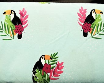 """Fabric cotton jersey printed patterns """"toucan"""" on a blue sky/green background"""