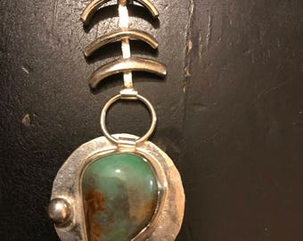 Petroglyph # 3 - Royston Turquoise, with a mauve hue and a silver ball