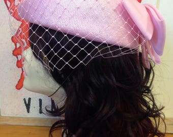 Vintage pink Headways formal hat with veil/ netting and bow detail