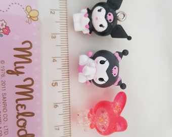 My melody and kuromi figurines