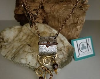 Medieval look to this hammered nickel folded and copper wired bail pendant necklace