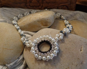 Elegant wedding, prom, evening, Black Hematite and White glass/crystal pearls form this choker necklace with center focal