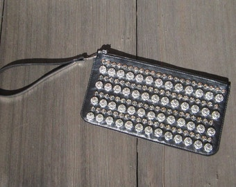 Black leather with silver-tone stud wristlet
