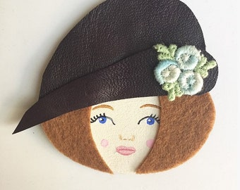 Brooch with plum leather Hat woman face