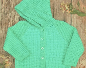 Little girl's toddlers childs boys hand knitted green cashmere cotton blend jacket with a pixie hood.