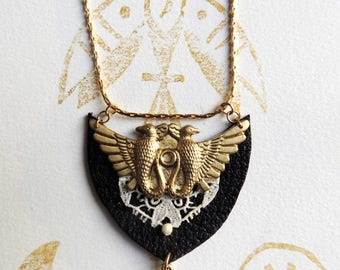 Necklace bird mirror