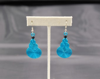 Lady's blue metal coil earrings