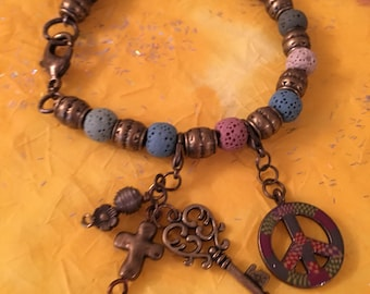 Bracelet with brass barrel spacers and retro charms and lava colored beads