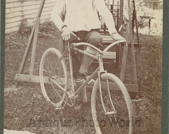 Boy with great bicycle antique cabinet photo
