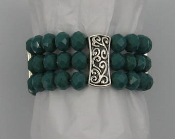 Green bead bracelet,glass beads,silver tone accents,stretchy, elastic
