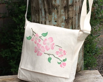 Dogwood blossoms handpainted on light cotton canvas messenger bag.  Pink blossoms for spring and summer purse, adjustable strap.