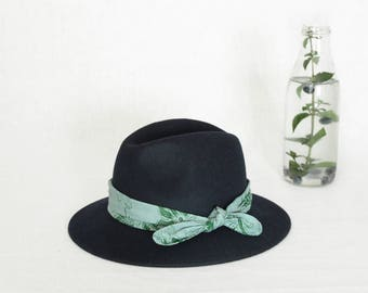 Blue fedora hat decorated with a batik scarf