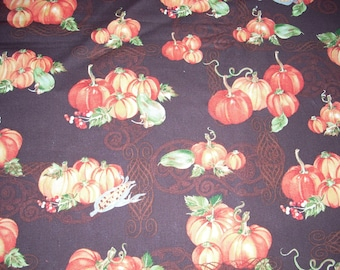 Pumpkins on Brown- Cotton fabric   42 inches wide sold by the yard