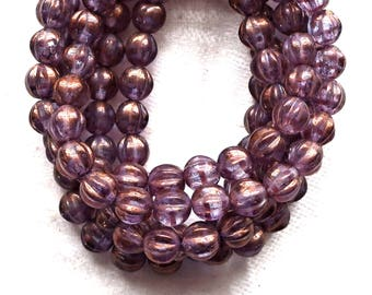 25 Czech glass melon beads, 6mm transparent, purple, lavender, amethyst pressed glass beads with a gold finish C0901