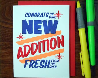 letterpress grocery store new baby congratulations greeting card neon orange ink with red blue congrats on your new addition