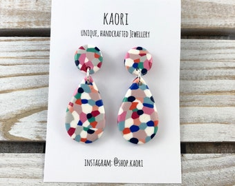 Handcrafted polymer clay stud dangle earrings in rainbow spots and dots
