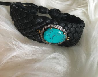 Woven leather cuff with turquoise pendent