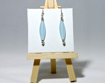 Silver dangle earrings with a smokey blue glass bead