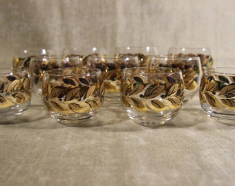 Set of 11 mid century gold black wreath roly poly's
