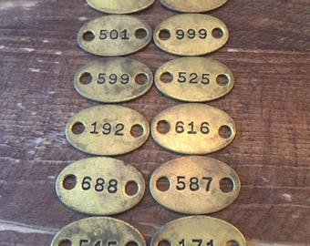 One Dozen Vintage Brass Numbered Tags