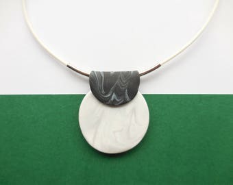 Modern and minimalistic necklace with marblelook hanger made of clay and silvercoloured details. black and white, handmade, nice as a gift