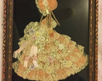 Vintage handmade framed silhouette of a ngirl in lace & ribbon