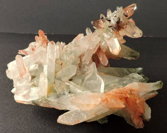 Rare cluster of quartz crystals with a pink blush, most tabular, some double terminated from Izizauen, Morocco - cabinet size