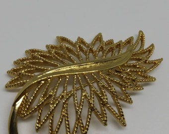 Monet textured gold tone leaf shaped brooch