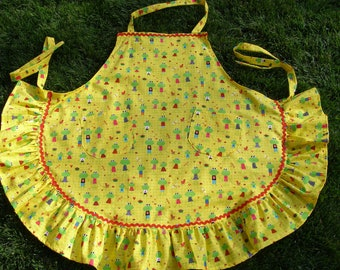 Bright yellow apron with frogs.