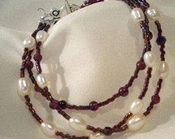 Garnet and Pearl Three Strand Bracelet