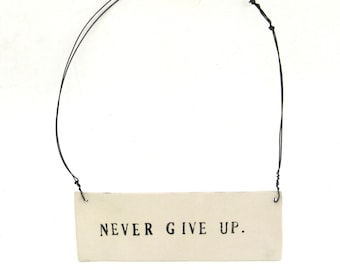 never give up   ...   inspiring tag   ...   hanging porcelain sign