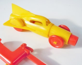Early Plastic Rocket Car / Shoots across the room on the Spring power created. / No Markings or Logos