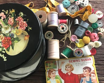 Vintage floral sewing notion tin filled with buttons, thread, scissors, and more!