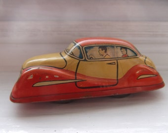 Vintage small tin windup car Germany