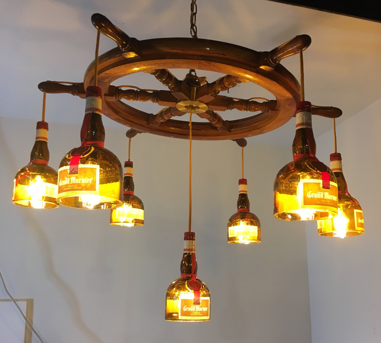 Huge grand marnier boat wheel 7 bottle chandelier zoom arubaitofo Choice Image